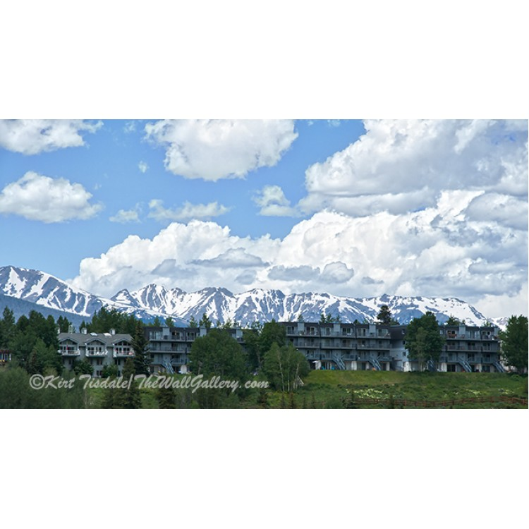 Clouds, Snow Capped Mountain Range And Condos